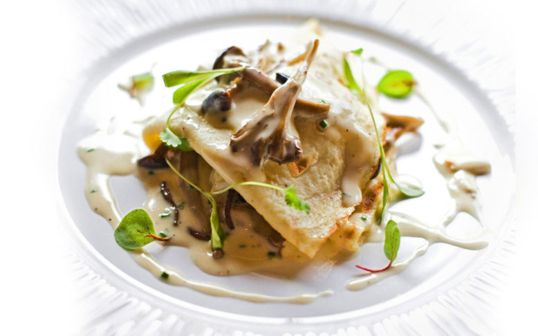 The lump crab and mushroom crêpe in beurre blanc served at Restaurant Lorena's